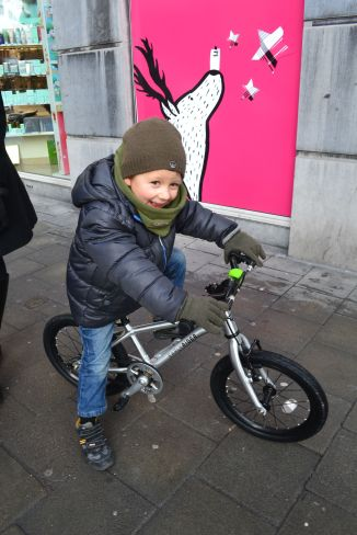 ©Barry Sandland/TIMB - Child on a bike in downtown Brussels/
