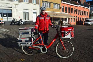 ©Barry Sandland/TIMB -Belgian postal worker on a bike.