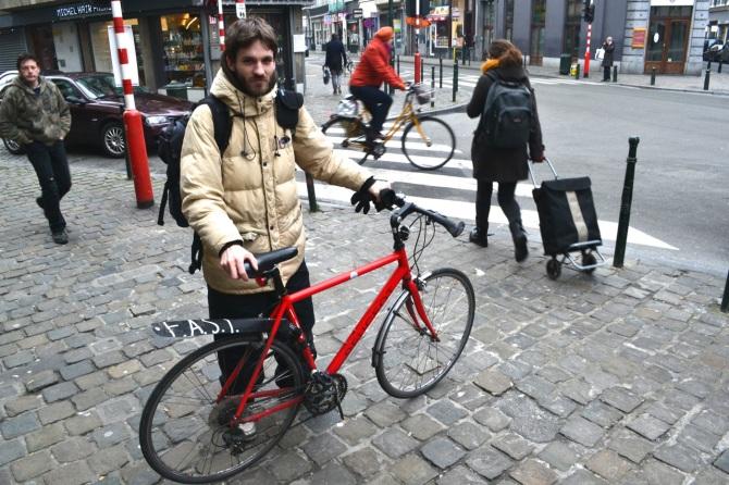 ©Barry Sandland/TIMB - Red Peugeot with bike messenger