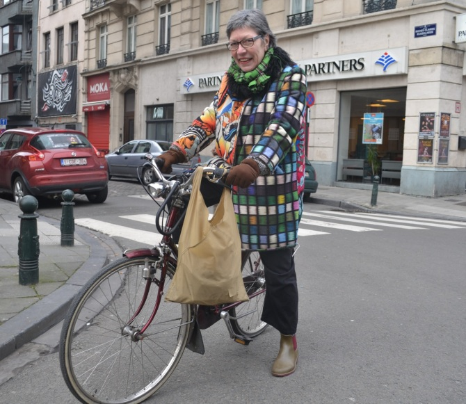 ©Barry Sandland/TIMB - Colourful coat on two wheels in Belgium