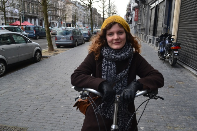 ©Barry Sandland/TIMB - Woman in scarf riding a bike