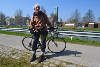 ©Barry Sandland/TIMB - Actor on his bike along a Belgiam canal