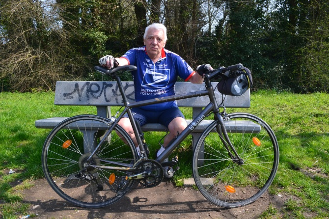 ©Barry Sandland/TIMB - Long time cyclist taking a respite on a park bench
