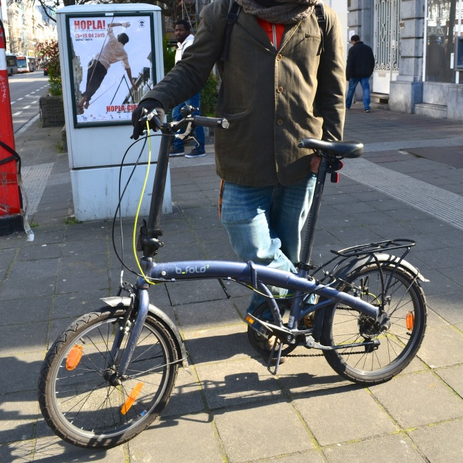 ©Barry Sandland/TIMB - Foldable b-fold bike with anonymous rider in Brussels