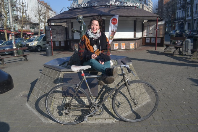 ©Barry Sandland/TIMB - Italian with her Novy road bike near one of Brussel's famous frites locations.