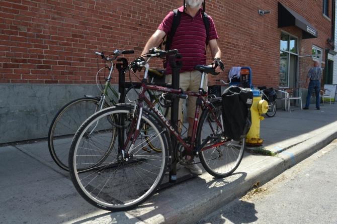 ©Barry Sandland/TIMB - Man with bike in Ottawa