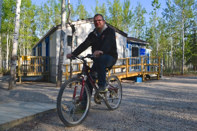 ©Barry Sandland/TIMB - Man with his montian bike at a camp ground