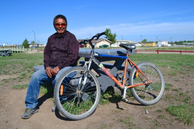 ©TIMB - Local with his bike in the Northwest Territories
