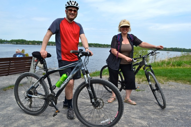 @Barry Sandland/TIMB - Two riders with their bikes in Ottawa