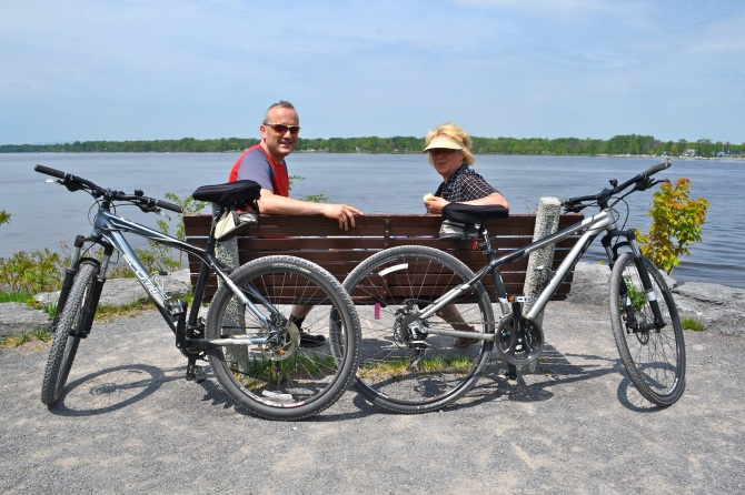 @Barry Sandland/TIMB- Two cyclists resting on a ark bench