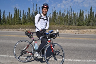 ©Barry Sandland/TIMB - Man preparing for a Race Across America qualifier on his Look bike in the Northwest Territories
