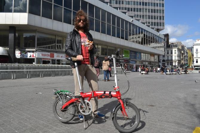 ©Barry Sandland/TIMB - Man with foldable bike and a waffle