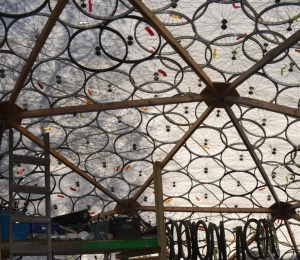©TIMB - Geodesic dome in Yelowknife with discarded wheels as extra support against snow