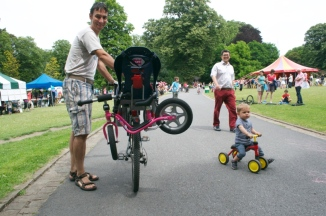 ©Barry Sandland/TIMB - Man with kid's bike attached to his bike