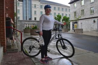 ©Barry Sandland/TIMB - Woman standing with her bike