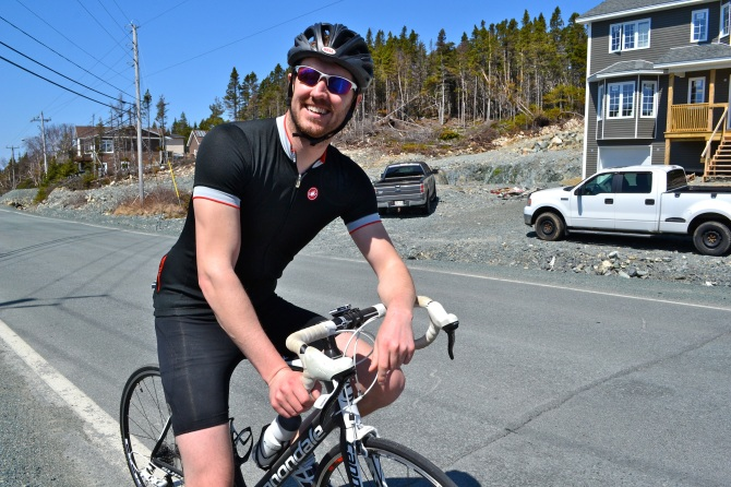 @Barry Sandland/TIMB - Cyclist on the road in Newfoundland