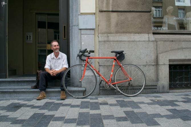 ©Barry Sandland/TIMB - Man with his vintage orange Peugeot bike