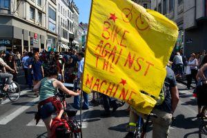 ©Barry Sandland/TIMB - Woman on bike with Bike Against the Machine slogan