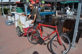 ©Barry Sandland/TIMB - Art vendor with his material on a cargo bike