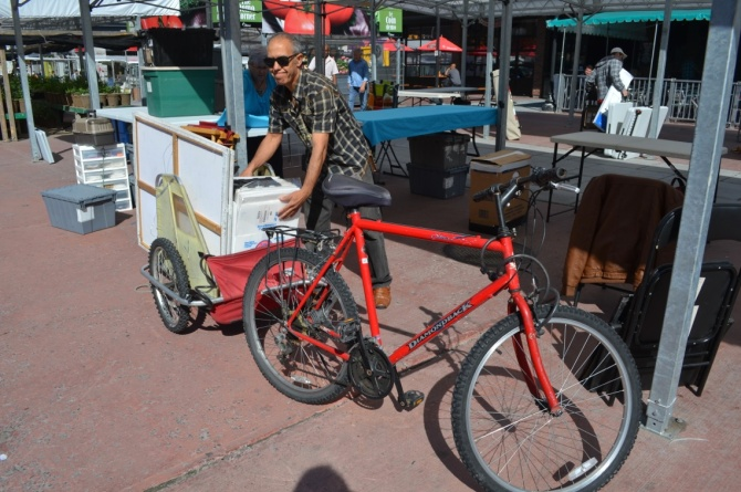 ©Barry Sandland/TIMB - Art vendor with his material on a cargo bike