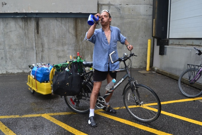 ©Barry Sandland/TIMB - Man blowing a vuvuzela as he returns bottles for cash