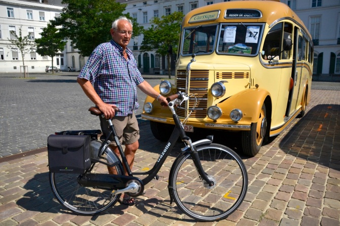 ©Barry Sandland/TIMB - Cyclist with bus from another era