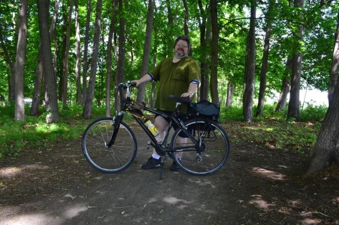 ©Barry Sandland/TIMB - Man with bike on Ottawa bicycle trail