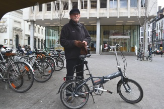 ©Barry Sandland/TIMB - Retired man on Stokvis foldable bike