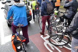 ©Barry Sandland/TIMB - Car and cyclists in a bicycle safety zone
