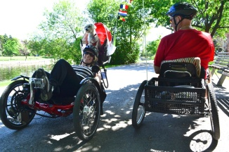 ©Barry Sandland/TIMB - Two para cyclists exchanging stories on an Ottawa bicycle path