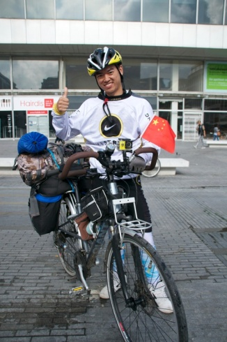 ©Barry Sandland/TIMB - Touring cyclist from China and his bike complete with panniers