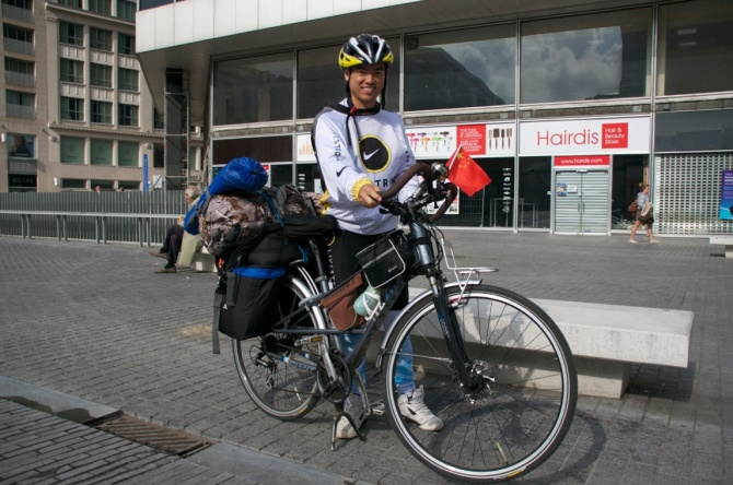 ©Barry Sandland/TIMB - Touring cyclist from China resting in Brussels