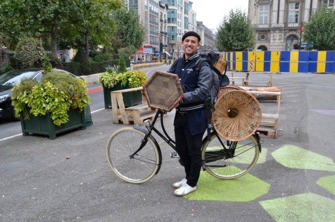 ©Barry Sandland/TIMB - Man carrying second-hand furniture on his bike