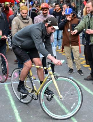 ©Barry Sandland/TIMB - Bikes messengers doing track stands at the Briuk bike market