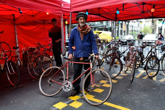 ©Barry Sandland/TIMB - Goldsmith with a vintage bike he is selling at a bicycle market