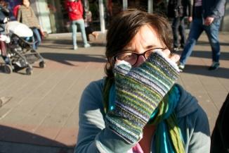 ©Barry Sandland/TIMB - Cyclist sporting her handmade woolen gloves.