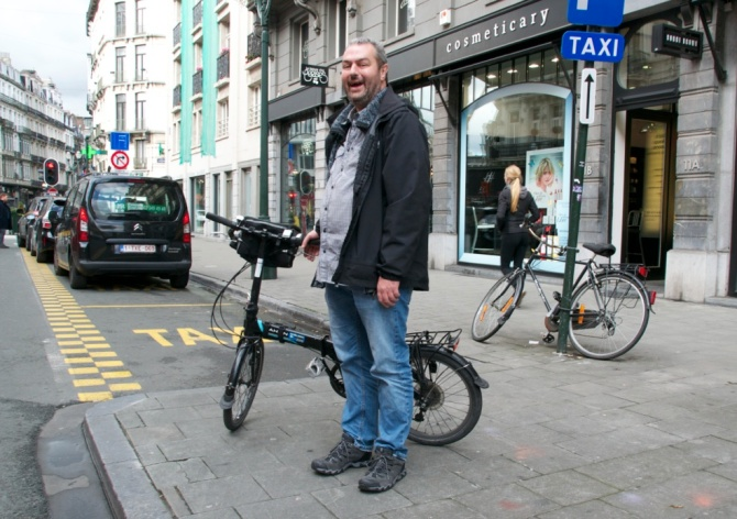 ©Barry Sandland/TIMB - Man with foldable Dahon bike in Brussels