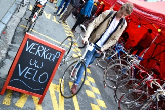 Barry Sandland/TIMB - Student walking past second hand bike market sign with his new bike
