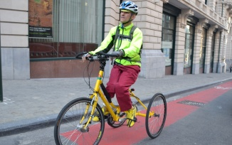 ©Barry Sandland/TIMB - Cyclist with spasticity riding tricycle in Brussels