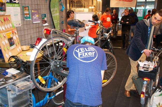 ©BArry Sandland/TIMB - Velofixer mechanics repaired biked for free at the Brik bike market event