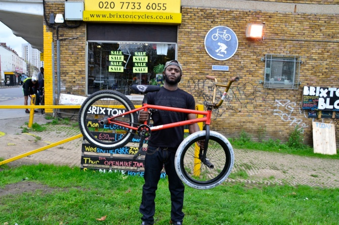 Barry Sandland/TIMB - Coop member outside Brixton Cyclers with his BMX