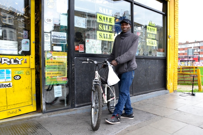 Barry Sandland/TIMB - Brixton Cyclmes supporter outside the shop