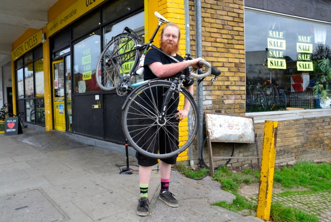 Barry Sandland/TIMB - Brixton Cycles mechanic and his bike