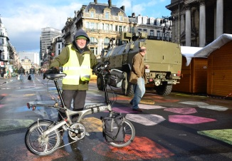 ©Barry Sandland/TIMB - French slow rider in Brussels near military vehicles