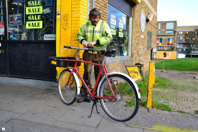 ©Barry Sandland/TIMB - Cargo riding gardener prepares his bike for the day at Brixton Cycles