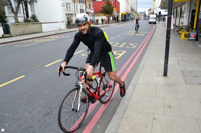 ©Barry Sandland/TIMB - Cyclist leaving Brixton Cycles to head to Heathrow