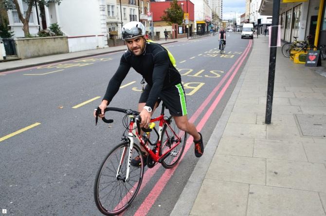 ©Barry Sandland/TIMB - Cyclist leaving Brixton Cycles to head to Heathrow