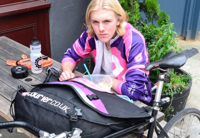 ©Barry Sandland/TIMB - Bike messenger in the UK resting between calls