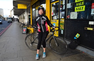 Barry Sandland/TIMB - Personal trainer outside Brixton Cycles shop w her road bike