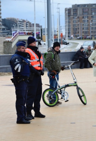 ©Barry Sadland/TIMB - Police watching the Ostend climate march w a man on a bicycle nearby